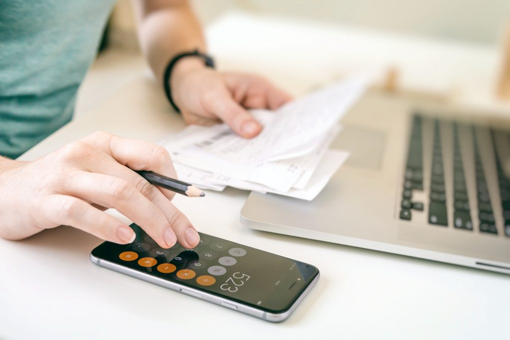 woman making audit of household spendings at home-account-accountant-analysis analysing annual audit
