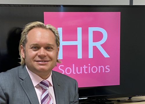 Dominic Greenwood with HR Solutions logo